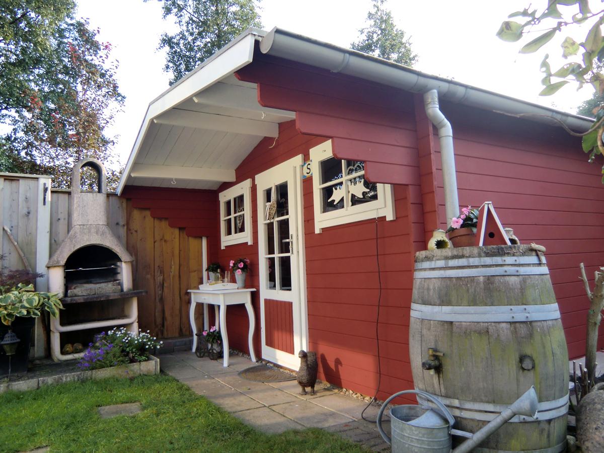 Tuinhuis verven met Moose Farg tuinhuis verf.